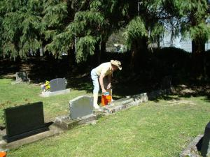 Bruce Routley cleans the family graves